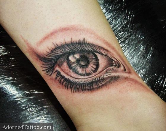 black and grey eye on ankle tattoo