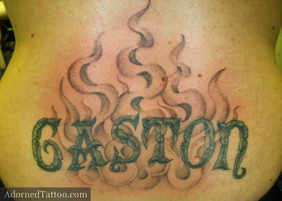 stone surname and dotwork smoke lower back tattoo
