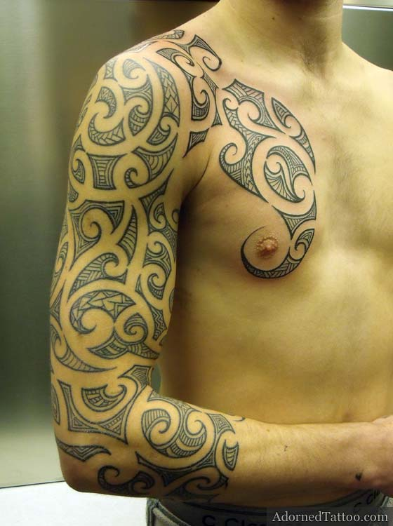 Maori-style sleeve and chest tattoo (front view)