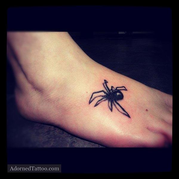 black widow spider foot tattoo adorned tattoo