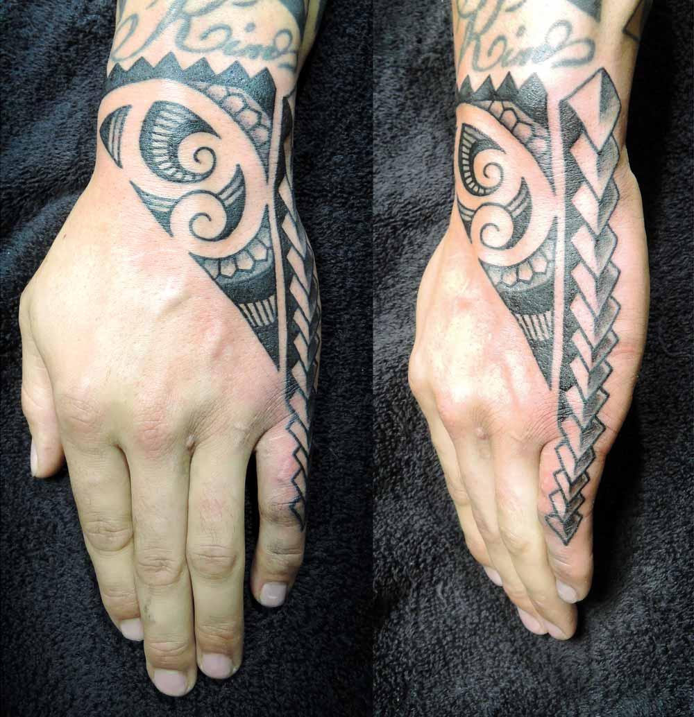 Maori Hand Tattoo: Script Inner Arm Tattoo