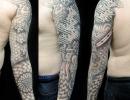 geometric dotwork sleeve tattoo by Alex