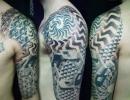 geometric dotwork tattoo by Alex