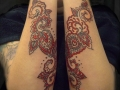 matching forearm tattoos by Alex